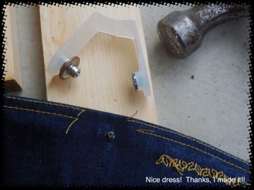 Poke your jeans button post through the hole.