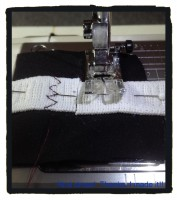 First of all, join your two elastic ends together by sewing them on to a scrap of cotton.